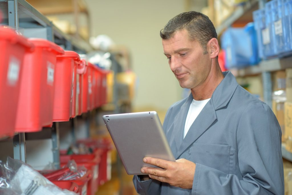 Warehouse worker using tablet